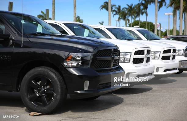 Ram trucks are seen on a sales lot on May 23 2017 in Miami Florida The US government is suing Fiat Chrysler for possibly cheating on emmision...
