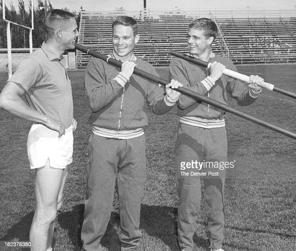MAY 21 1965 Ram Vault Stars Colorado State University pole vaulters Bob Flockhart and Bill Nelson get some tips from Coach Don Meyers prior to...