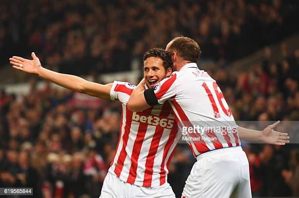 Ramadan Sobhi and Charlie Adam of Stoke City celebrate as Alfie Mawson of Swansea City scores an own goal for their second goal during the Premier...