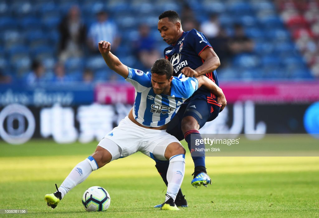 Ramadan Sobhi of Huddersfield Town and Kenny Tete of Olympique Lyonnais in action during a pre-season friendly match between Huddersfield Town and Olympique Lyonnais at John Smith's Stadium on July 25, 2018 in Huddersfield, England.