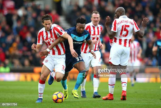 Ramadan Sobhi of Stoke City and Adama Traore of Middlesbrough battle for possession during the Premier League match between Stoke City and...