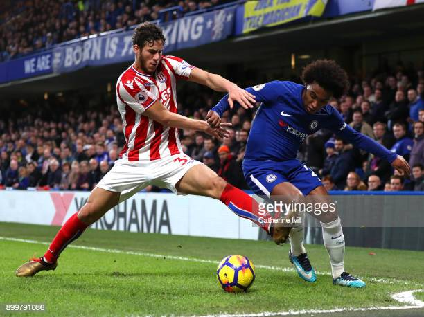 Ramadan Sobhi of Stoke City and Willian of Chelsea battle for possession during the Premier League match between Chelsea and Stoke City at Stamford...