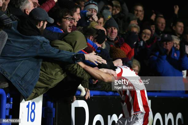 Ramadan Sobhi of Stoke City celebrates with the fans after scoring his sides first goal during the Premier League match between Huddersfield Town and...