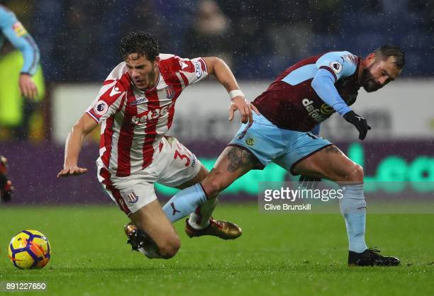 Ramadan Sobhi of Stoke City in action with Steven Defour of Burnley during the Premier League match between Burnley and Stoke City at Turf Moor on...