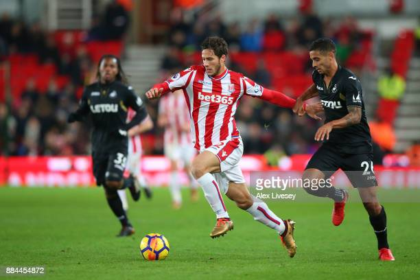 Ramadan Sobhi of Stoke City is challenged by Kyle Naughton of Swansea City during the Premier League match between Stoke City and Swansea City at...