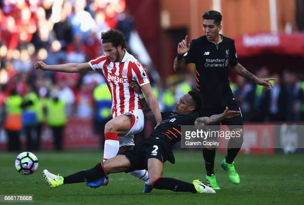 Ramadan Sobhi of Stoke City is tackled by Nathaniel Clyne of Liverpool during the Premier League match between Stoke City and Liverpool at Bet365...