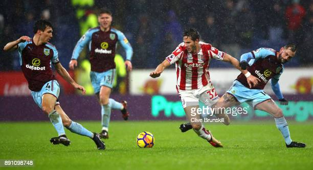 Ramadan Sobhi of Stoke City is tackled by Steven Defour of Burnley during the Premier League match between Burnley and Stoke City at Turf Moor on...