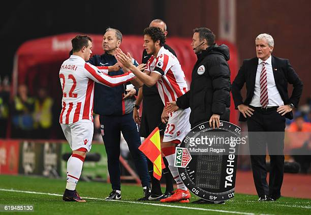 Ramadan Sobhi of Stoke City replaces Xherdan Shaqiri of Stoke City as a substitute as Mark Hughes manager of Stoke City looks on during the Premier...