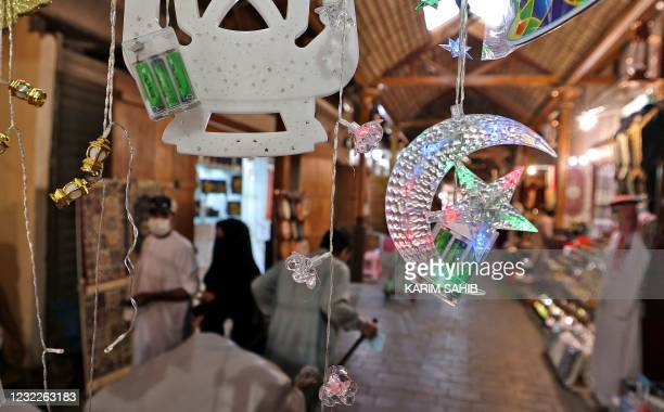 Ramadan-inspired decorations hang at a market in Dubai in the United Arab Emirates as people shop ahead of the Muslim fasting month, on April 12,...