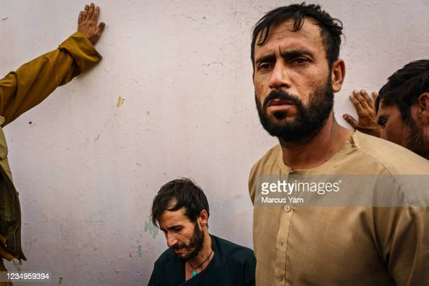 Ramal Ahmadi left, and Emal Ahmadi, right, mourns the loss of 10 members of their family killed after a vehicle in their home was targeted and hit...