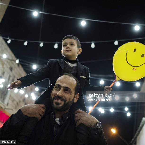 Ramallah Majd Rimawi and his uncle Mazen between the Ramallah streets He is the son of Abdel Karim who has been arrested since June 2001 and...