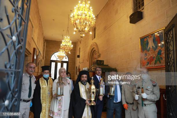 Ramallah and alBireh Governor Laila Ghannam is seen upon the arrival of Holy Fire brought from the Church of the Holy Sepulchre from Jerusalem during...