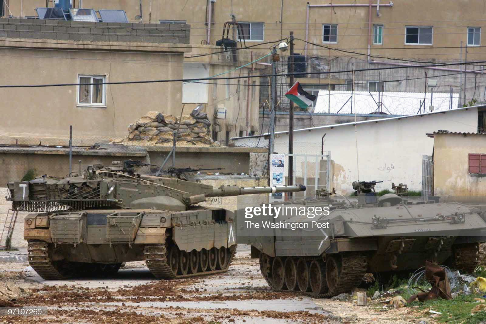 https://media.gettyimages.com/photos/ramallah-west-bank-32902-israeli-tanks-and-armored-personnel-carriers-picture-id97197260?s=2048x2048