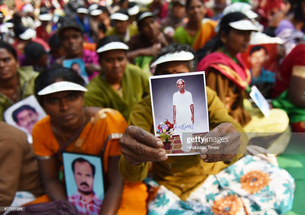 Ramanamma from Andhra Pradesh, holding picture of her husband Laxmayya who committed suicide during a demonstration in support of their various long pending demands at Jantar Mantar on November 21, 2017 in New Delhi, India. A Kisan Sansad, or Farmers Parliament, comprising members from over 25 states gathered in capital to press demands for fair crop prices and loan waivers, returning the spotlight to prevailing agrarian distress.