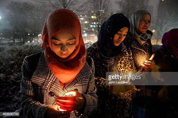 Ramate Said Risaa Jaia attend a candle light vigil February 15, 2015 at Civic Center for three students who were killed last week in N.C.Muslim...