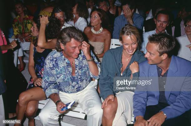 Ramatuelle Festival From left to right French singer Johnny Hallyday Estelle Hallyday with her husband the french singer and songwriter David...