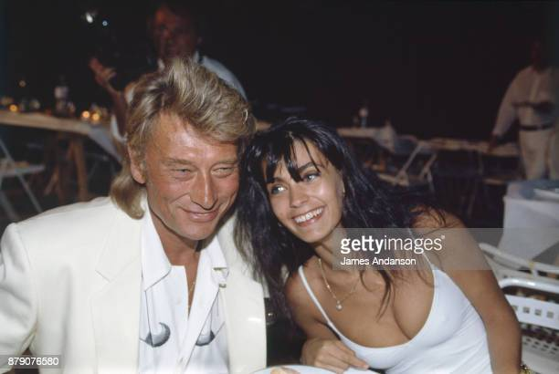 Ramatuelle French singer Johnny Hallyday and his wife Adeline at Eddie Barclay's reception 27th July 1991