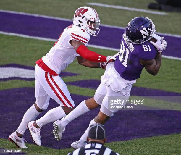 Ramaud Chiaokhiao-Bowman of the Northwestern Wildcats catches a touchdown pass in front of Donte Burton of the Wisconsin Badgers at Ryan Field on...