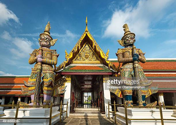 Ramayana Giants statues standing in Temple of The Emerald Buddha or Wat phra Kaew Bangkok Thailand