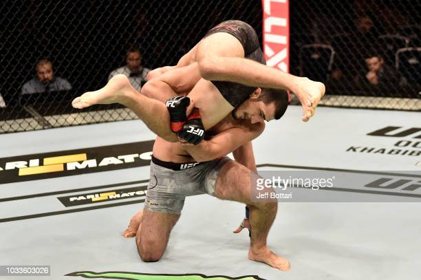 Ramazan Emeev of Russia attempts to take down Stefan Sekulic of Serbia in their welterweight bout during the UFC Fight Night event at Olimpiysky...