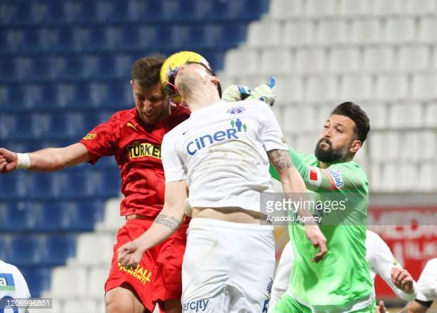 Ramazan Kose of Kasimpasa in action against Kamil Antoni Wilczek of Goztepe during the Turkish Super Lig soccer match between Kasimpasa and Goztepe,...