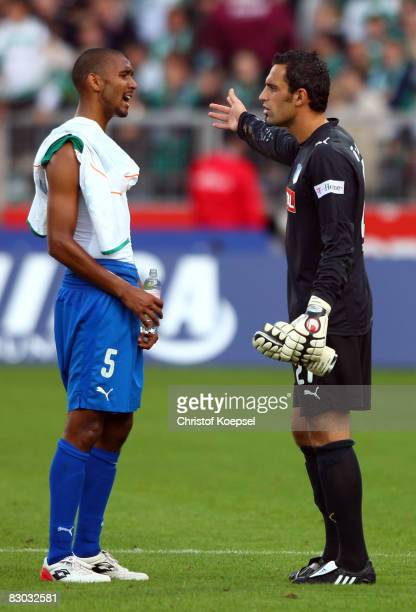Ramazan Oezcan of Hoffenheim discusses with Marvin Compper after loosing 45 the Bundesliga match between Werder Bremen and 1899 Hoffenheim at the...