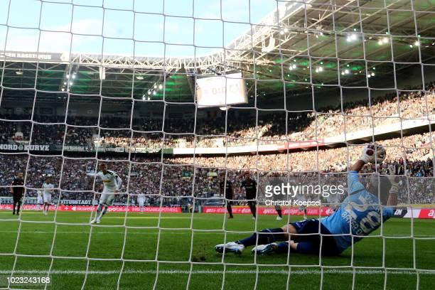 Ramazan Oezcan of Leverkusen saves the penalty of Thorn Hazardf of Moenchengladbach during the Bundesliga match between Borussia Moenchengladbach and...