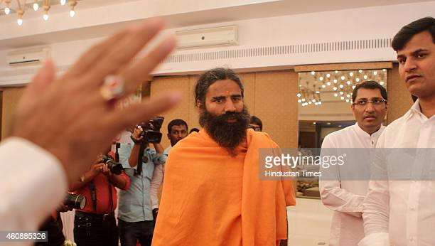Ramdev Baba attending the prayer meeting of Varija Shetty mother of his follower Sudhakar Shetty at Tulip Star Hotel Juhu on December 28 2014 in...