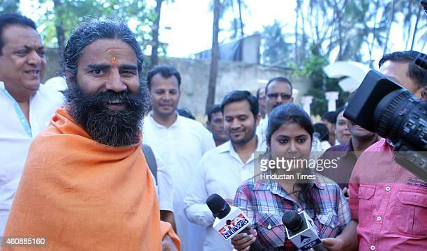 Ramdev Baba talks with media after attending the prayer meeting of Varija Shetty mother of his follower Sudhakar Shetty at Tulip Star Hotel Juhu on...