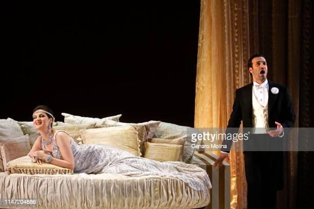 "Rame Lahaj, right, and Adela Zaharia perform in Los Angeles Opera's production of Verdi's ""La Traviata,"" at the Dorothy Chandler Pavilion in Los..."
