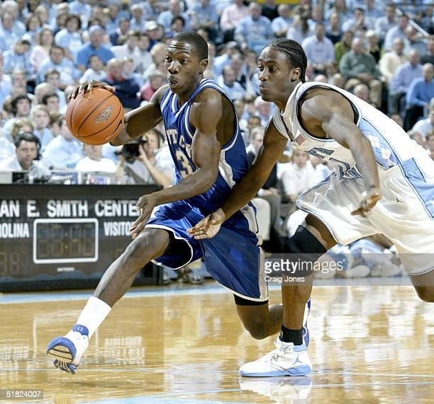 Ramel Bradley of the Kentucky Wildcats tries to drive by Quentin Thomas of the North Carolina Tar Heels on December 4 2004 at the Dean E Smith Center...