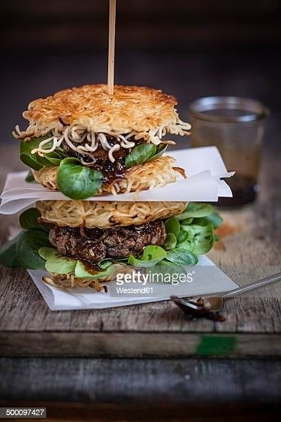 ramen burgers, with beef patties and lamb's lettuce - shoyu stock photos and pictures