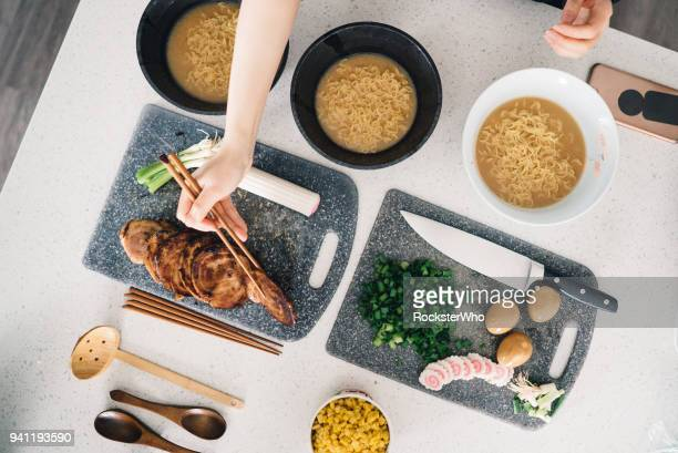 Ramen ingredients being prepared in the kitchen