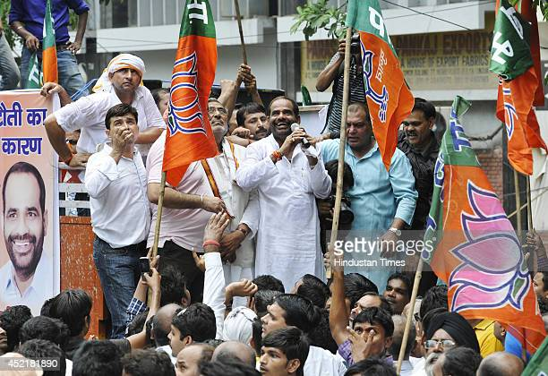 Ramesh Bhiduri led protest by BJP workers at the BSES headquarters in Nehru Place against the high Electricity prices on July 15 2014 in New Delhi...