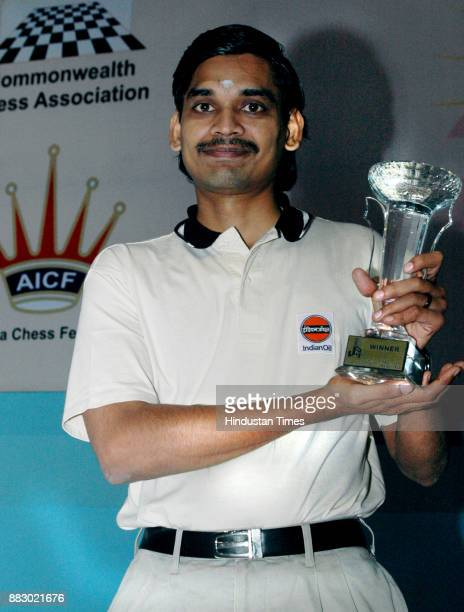 Ramesh in happy mood with commonwealth chess championship Troffy on Monday at New Delhi