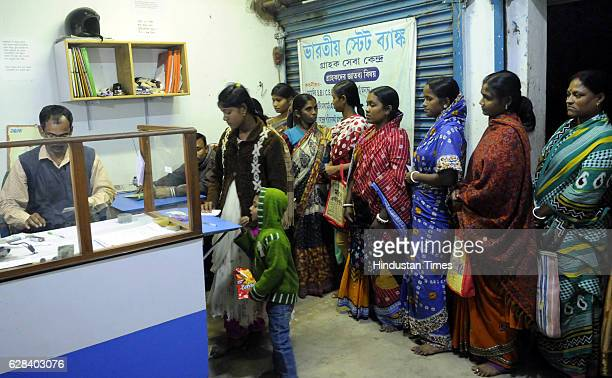 Ramesh Mistry customer service point operator of SBI at Laxbagan Satjelia island of Sunderban working with patience to tackle the cash crisis on...