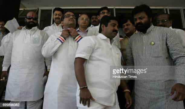 Ramesh Wanjle Shishir Shinde Nitin Sardesai Ram kadam Vasant Gite gesture's at Media during monsoon session of Vidhan Bhavan in Mumbai on Tuesday