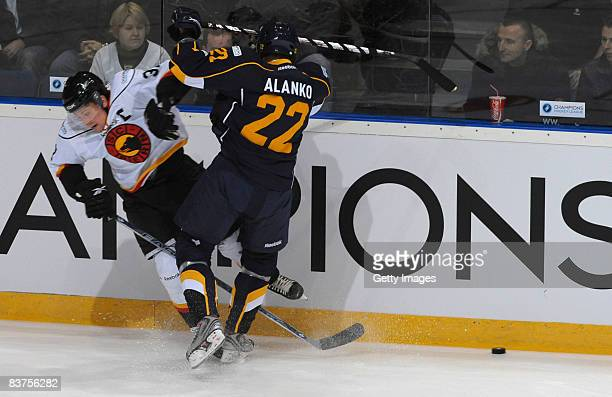 Rami Alanko of Espoo Blues fights for the puck during the IIHF Champions Hockey League match between Espoo Blues and SC Bern on November 19, 2008 in...