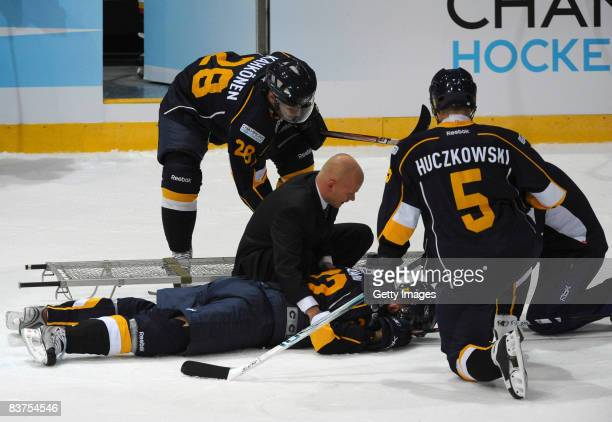 Rami Alanko of Espoo Blues lies on the ground during the IIHF Champions Hockey League match between Espoo Blues and SC Bern on November 19, 2008 in...