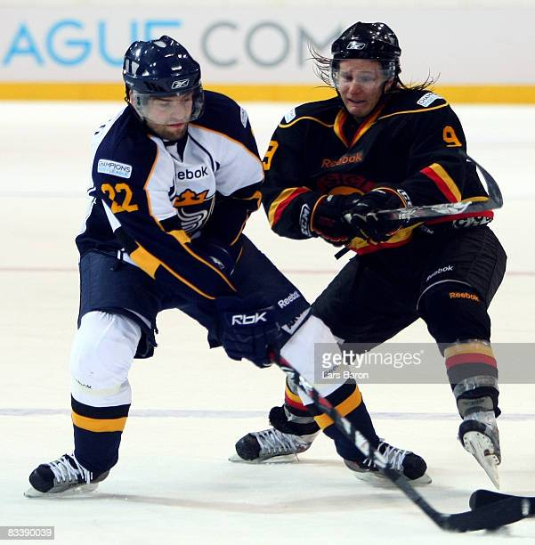 Rami Alanko of Espoo in action with Simon Gamache of Bern during the IIHF Champions Hockey League match between SC Bern and Espoo Blues at the...