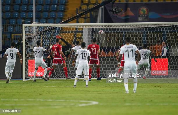 Rami Bedoui of Tunisia scoring an own goal to 1-1 during the 2019 African Cup of Nations match between Ghana and Tunisia at the Ismailia Stadium in...