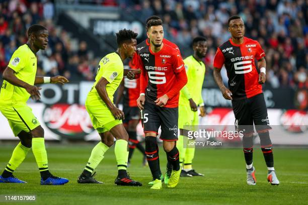 Rami Bensebaini and Mexer of Rennes during the Ligue 1 match between Stade Rennais football club and LOSC Lille Association on May 24 2019 in Rennes...