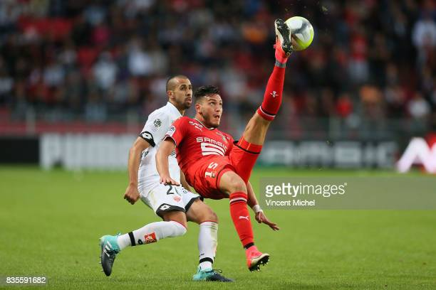 Rami Bensebaini of Rennes and Fouad Chafik of Dijon during the Ligue 1 match between Stade Rennais and Dijon FCO at Roazhon Park on August 19 2017 in...