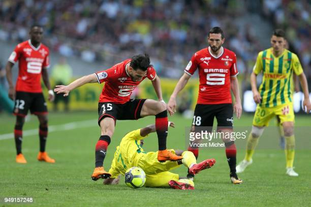 Rami Bensebaini of Rennes and Jules Iloki of Nantes during the Ligue 1 match between Nantes and Rennes at Stade de la Beaujoire on April 20 2018 in...