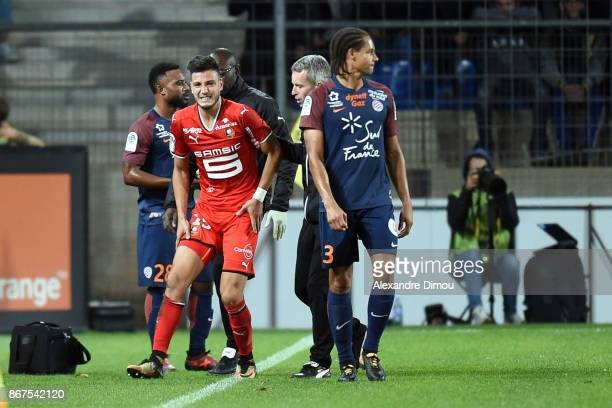 Rami Bensebaini of Rennes exit injuired during the Ligue 1 match between Montpellier Herault SC and Stade Rennais at Stade de la Mosson on October 28...
