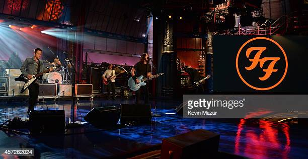 Rami Jaffe, Nate Mendel, Taylor Hawkins, Dave Grohl, Chris Shiflett and Pat Smear of Foo Fighters perform onstage after the premiere of Foo Fighters...