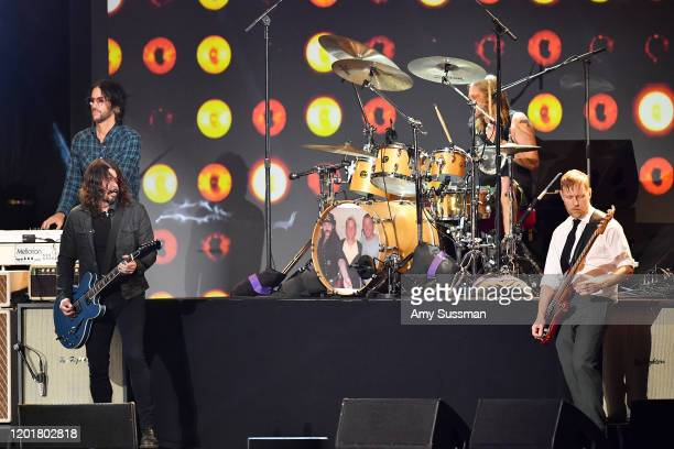 Rami Jaffee Dave Grohl Taylor Hawkins and Nate Mendel of Foo Fighters perform onstage during MusiCares Person of the Year honoring Aerosmith at West...