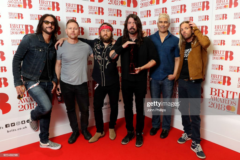 Rami Jaffee, Nate Mendel, Chris Shiflett, Dave Grohl, Pat Smear and Taylor Hawkins of Foo Fighters, winner of the Best International Group award, pose in the winners room during The BRIT Awards 2018 held at The O2 Arena on February 21, 2018 in London, England.