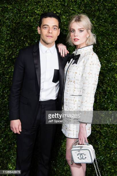 Rami Malek and Lucy Boynton attend the Charles Finch Chanel preBAFTA's dinner at Loulou's on February 09 2019 in London England