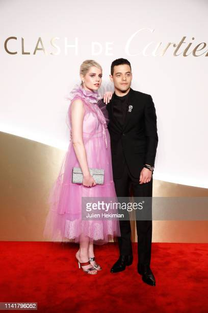 Rami Malek and Lucy Boynton attend the 'Clash De Cartier' Launch Photocall At La Conciergerie In Paris on April 10 2019 in Paris France